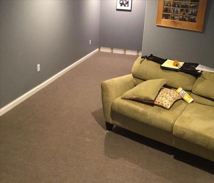 Carpet cleaned and dried with a portion of the baseboard and drywall removed