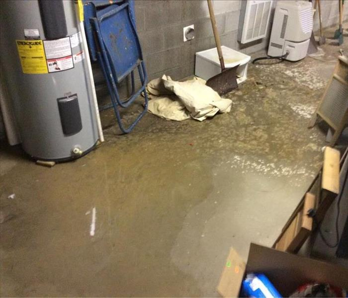 Sewage water on concrete floor in basement