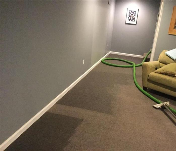 Wet carpet in basement family room